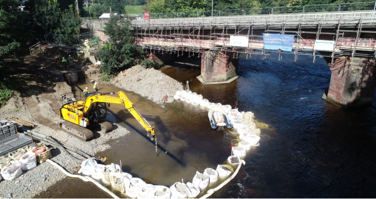 works in river installing emergency overflow outfall for pump station