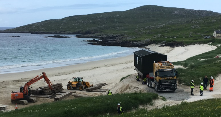 The new Water Treatment Works leaves Huisinis Beach, following its delivery by sea