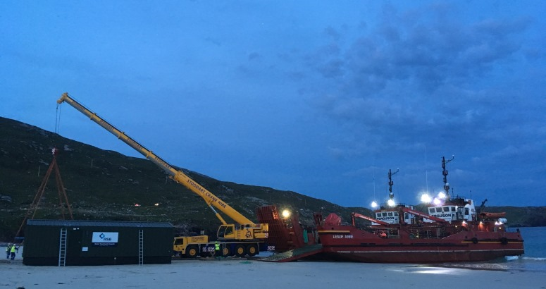 The new Water Treatment Works being unloaded on to Huisinis Beach in North Harris