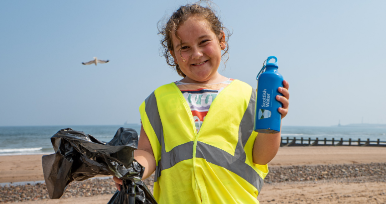 Young litter picker staying hydrated