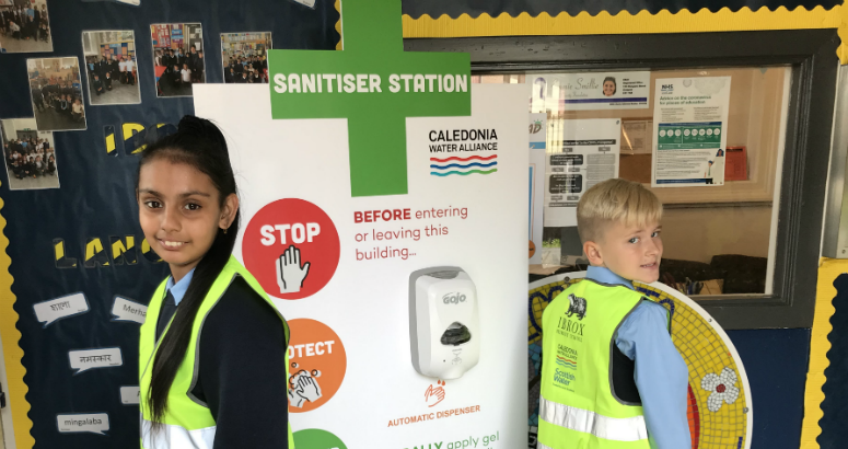 Pupils at one of the sanitiser stations