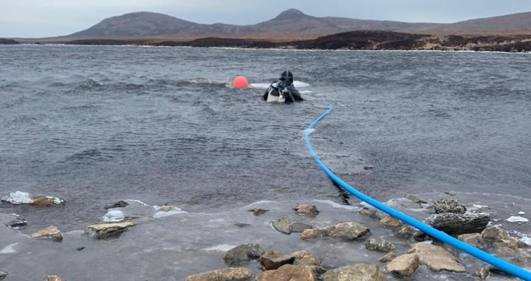 A diver working to clear intakes of ice in Loch Fada, near Lochmaddy in North Uist, February 2021