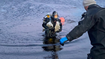 Divers working to clear intakes of ice at Loch Fada in North Uist, February 2021