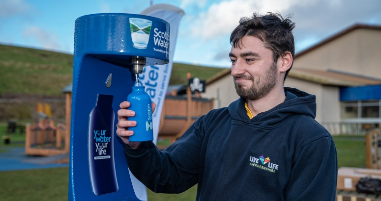 Cameron Smith from Live Life Aberdeenshire's Stonehaven Leisure Centre putting the town's new Top up Tap into use