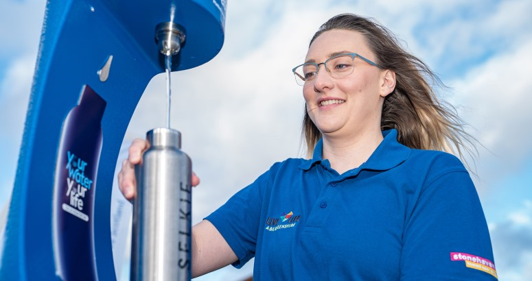 Kelsea Murray from Live Life Aberdeenshire's Stonehaven Leisure Centre putting the town's new Top up Tap into use