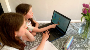 Children using online learning pack at home