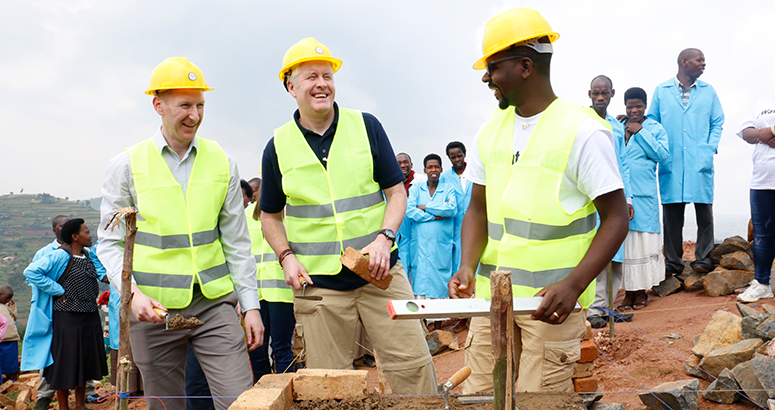 Ewan Robertson helps build new school latrines in Rwanda