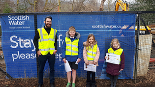 Callander schoolkids presented with wood owl