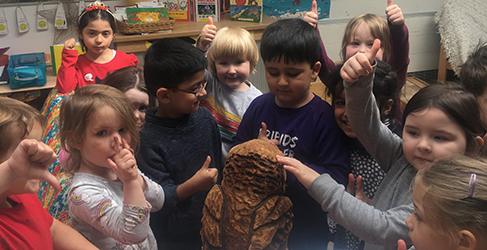 Hillhead Primary kids welcome wood carvings on River Kevlin