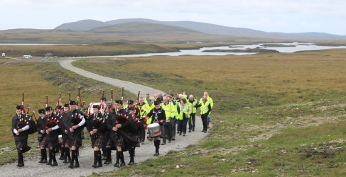 Sgoil Lionacleit Pipe Band  with Loch Fada behind