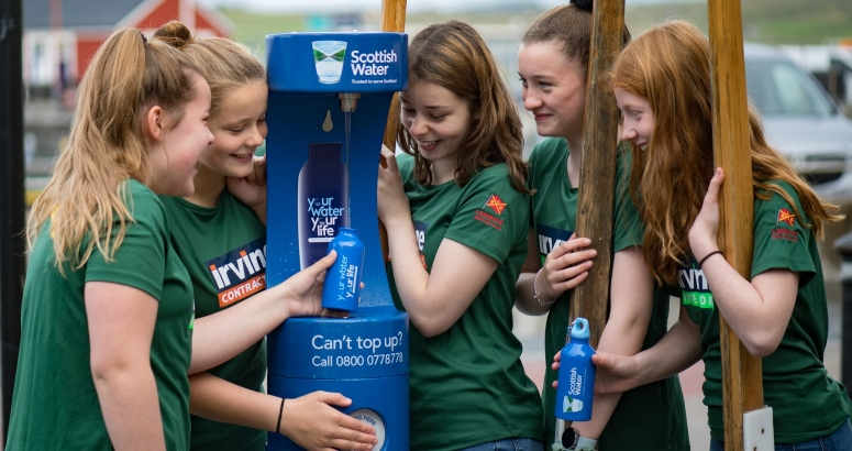 The U16 Lasses of Lerwick Boating Club refill their bottles at the new Top Up Tap