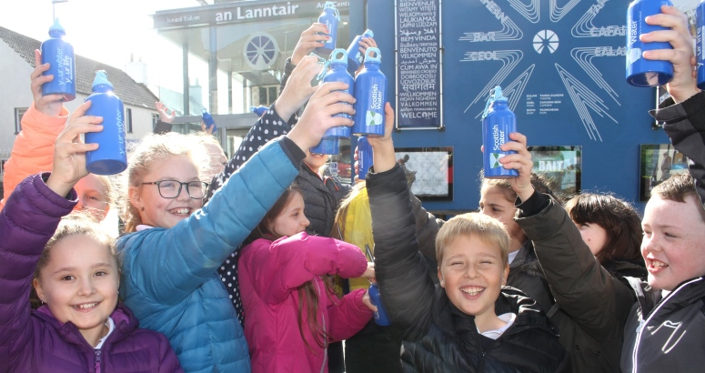 P6 and P7 pupils from Back Primary School say cheers to Scottish Water's new Top Up Tap
