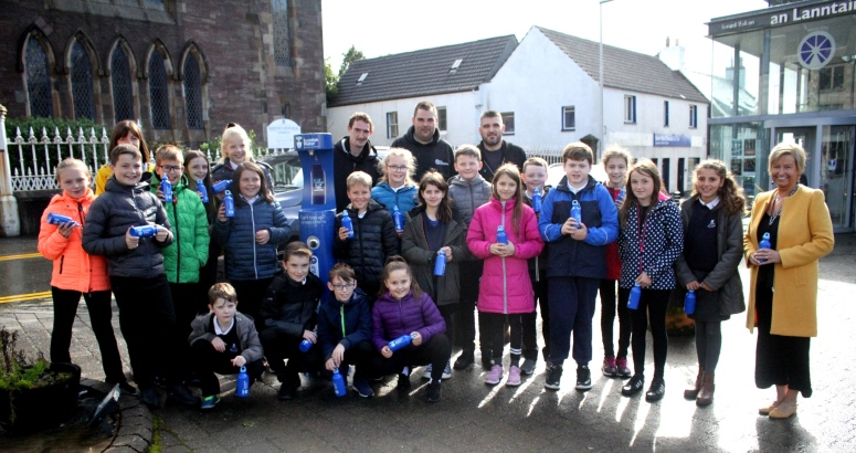 Pupils from Back Primary School pictured with Peat & Diesel at the Top Up Tap