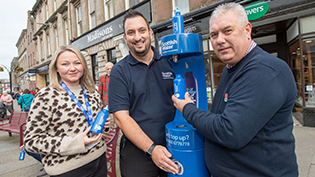 Walk and Talk Co-ordinator Gemma Lownie, Clive Duncan of Scottish Water and Cllr Tommy Stewart pictured at the new Top Up Tap on Montrose High Street