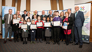 Scarf 2020 school calendar competition winners receiving their awards at the Scottish Parliament