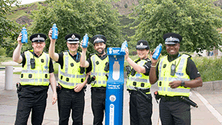Police Officers at the top up tap