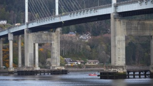 Specialist contractors abseiling from the Kessock Bridge near Inverness to repair water main